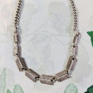 Silver Fossil Necklace with Arrow Feathers